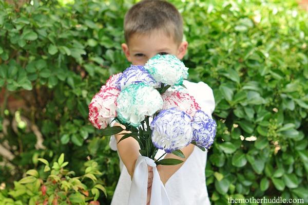 Child-Boy-Holding-Flowers