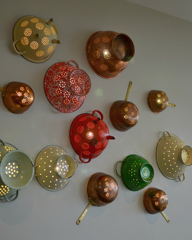 upcycled colander wall lights