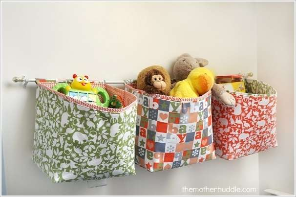 Fabric Baskets Hung from a Curtain Rod