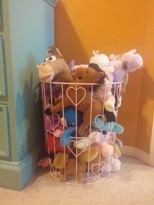use a wire basket to storage stuffed animals