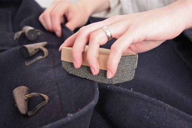 Use a pumice stone or lint roller to de-fuzz a sweater