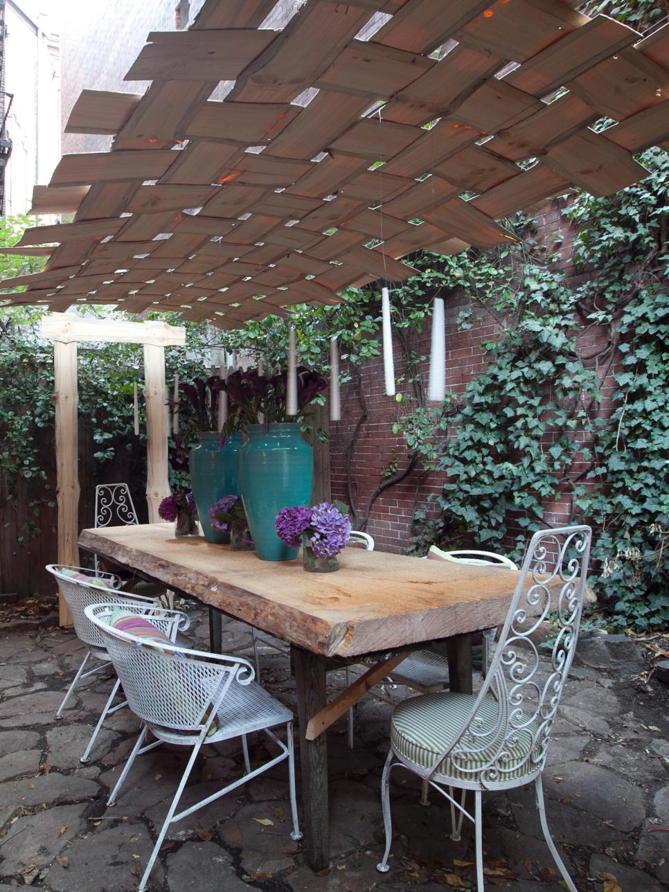 10 Creative DIY Outdoor Shady Space Ideas----Thin pieces of wood veneer were woven together like a basket to create a unique canopy suspended above an outdoor dining area.